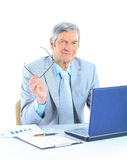The businessman of works. The businessman at the age of works for the laptop.  on a white background Royalty Free Stock Photography