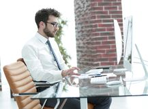 Businessman works with business papers. At your Desk Stock Images