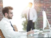 Businessman works with business papers. At your Desk Stock Image