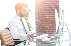 Businessman works with business papers. At your Desk Stock Photo