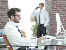 Businessman works with business papers. At your Desk Royalty Free Stock Photos