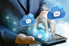 Businessman works with cloud mail. A concept design Stock Photos