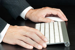 Businessman Works On Computer. Close-up of a businessman working on a computer keyboard Royalty Free Stock Photos