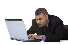Businessman works concentrated on laptop Royalty Free Stock Photo