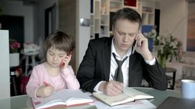 Businessman Works From Home And Takes Care Of His Little Daughter Stock Images