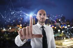 Businessman works with futuristic internet interface royalty free stock photography