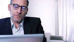 Businessman works with ipad - reflections stock footage