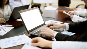 Businessman works on laptop at business meeting, developing strategy, conference. Stock footage Stock Photos
