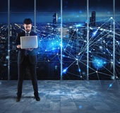 Businessman works with laptop and internet network. Businessman works with laptop with futuristic lights like a internet network Stock Photo