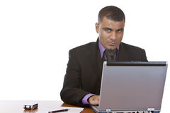 Businessman works in office on laptop Royalty Free Stock Image