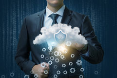 Businessman works with protected information. Businessman works with protected information cloud Stock Images