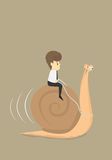 Businessman works slowly like snail Royalty Free Stock Images