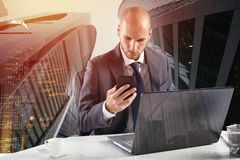 Businessman works with smartphone and laptop Stock Photo
