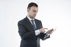 Businessman works with tablet. On white background Stock Photo