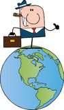 Businessman on a world globe Royalty Free Stock Images