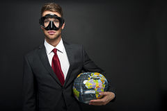 Businessman with world globe Stock Photography