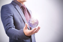 Businessman with the world in his hand Stock Images