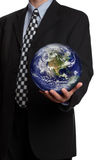 Businessman with the world in his hands Royalty Free Stock Photos