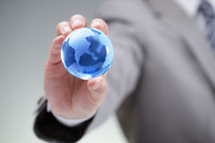 Businessman with the world in his hands Royalty Free Stock Photo