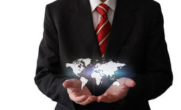 Businessman with a world map Stock Photos