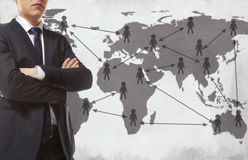 Businessman with world map Royalty Free Stock Images
