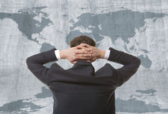 Businessman with world map Royalty Free Stock Photography