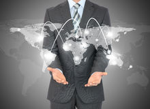 Businessman with world map in hands Stock Photos