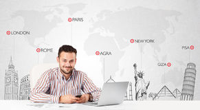 Businessman with world map and major landmarks of the world Stock Photo