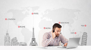 Businessman with world map and major landmarks of the world Stock Image