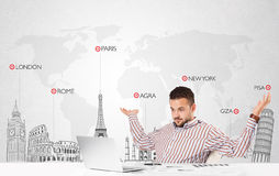 Businessman with world map and major landmarks of the world Royalty Free Stock Photos