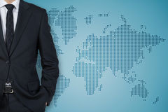 Businessman and world map Royalty Free Stock Image