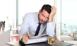 Businessman worried by the bad financial news Royalty Free Stock Photography