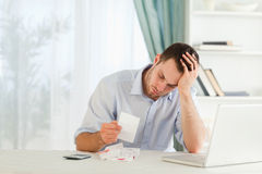 Businessman worried about bills. Young businessman worried about bills royalty free stock photography