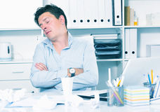 Businessman worrying at office Stock Image