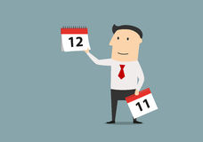 Businessman woth calendar of last month of year. Cartoon businessman showing on the tear off calendar and the last month of the year. Time management or planning Royalty Free Stock Photo