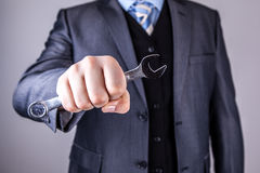 Businessman wrench tools Stock Image