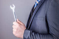 Businessman wrench tools Stock Photography
