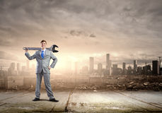Businessman with wrench Royalty Free Stock Image