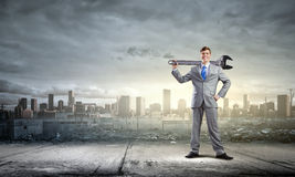 Businessman with wrench Stock Photo