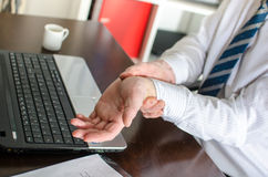 Businessman with wrist pain Royalty Free Stock Photo
