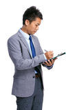 Businessman write on clipboard Stock Photography