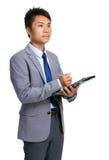 Businessman write on clipboard Stock Image