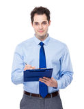 Businessman write on clipboard Stock Image