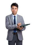 Businessman write on clipboard Royalty Free Stock Photos