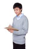 Businessman write on clipboard Royalty Free Stock Photo