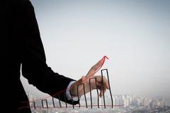 Businessman write graph Royalty Free Stock Image