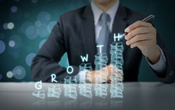 Businessman write increasing money graph with growth Stock Photography