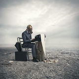 Businessman write with an old typewriter Royalty Free Stock Photos