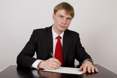 Businessman write on paper Stock Photo