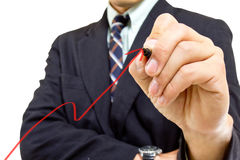 Businessman write red graph Royalty Free Stock Photo